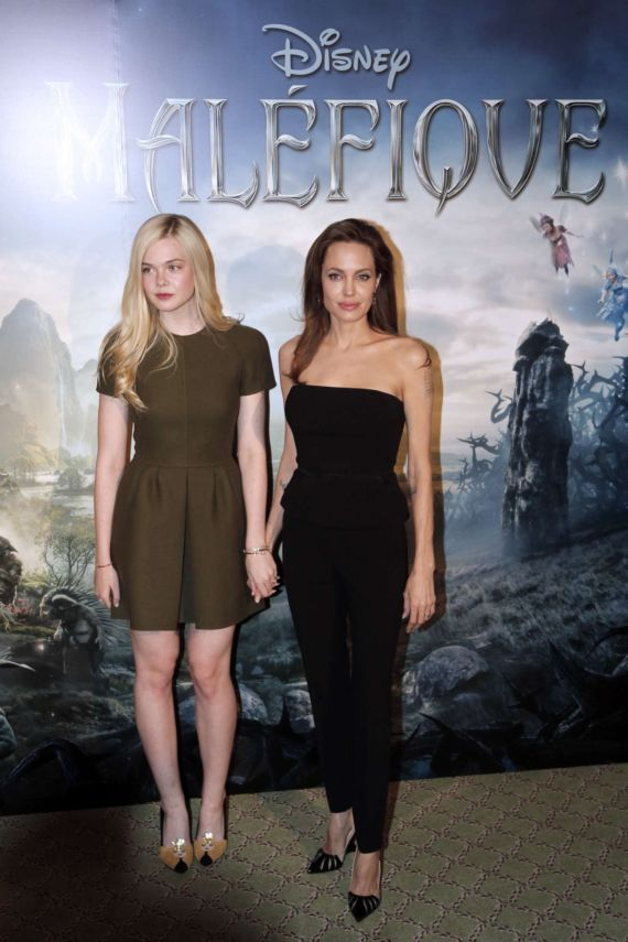 Elle Fanning And Angelina Jolie At Maleficent Photocall