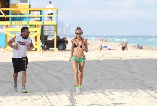 Exercising Laura Cremaschi On The Beach